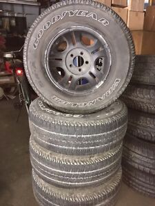 235/75R15 Goodyear Wrangler SR-A tires and rims