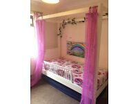 Traditional Four-Poster bed. White wood. Great condition. Less than a year old.