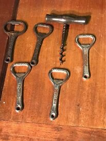 Selection of vintage bottle openers and cork screw