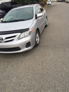 2012 TOYOTA COROLLA +4 WINTER TIRES ON RIMS, LOW KM