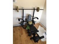 Dumbbells and weights with bench