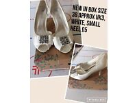 Size 3 white heels brand new in box