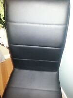 2 new modern black leather dinning chairs
