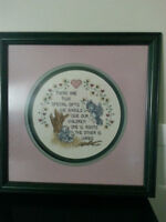 Professionally-framed cross-stitch