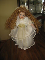 20 inch Porcelain doll in chair