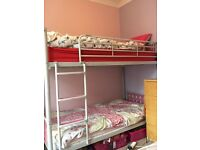 Solid silver metal bunk beds with pink head and foot boards