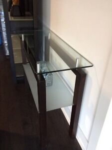 Modern glass and wood console table.