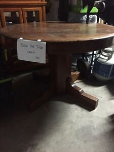 Antique sold round oak table