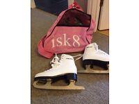 Like new white girls ice skates and pink skate bag!