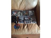 PS3 with 7 games in cases