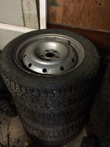 Set of four Subaru rims with winter tires