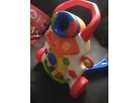 Musical baby walker with shapes and balls never used very good con