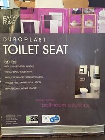Grey toilet seat brand new in box