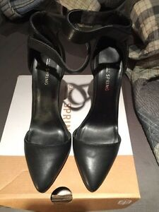 Spring heels size 8