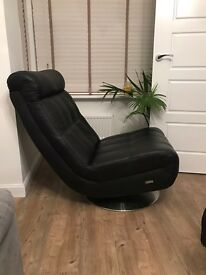 Contemporary black leather swivel chair and footstool.