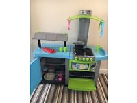 Children's play kitchen with food and accessories