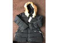 Brand new coat says large on label but I wud say medium Fur hood part is removable