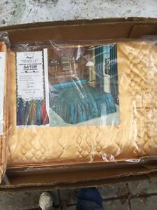 Brand new Royal Seville satin bed cover and draw drapes.