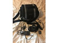 Canon 400D DSLR camera with accessories