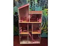 Wooden dolls house with dolls and furnitures