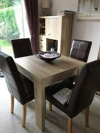 Dining table & chairs. Extendable plus two side units.