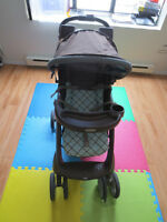 Graco Stroller with rain cover in good condition for sale.