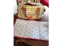 Pink lining yummy mummy bow bag