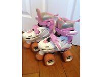Girls SFR Storm Racing adjustable roller skates with quad wheels