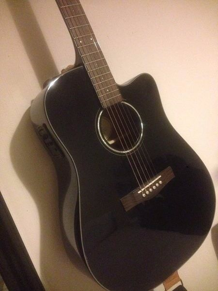 Fender Electro-acoustic guitar with strap