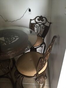Metal dining room table Top is glass With 4 swivel chairs Cambridge Kitchener Area image 4
