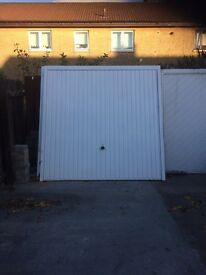 2 X Up and over white Garador garage doors.