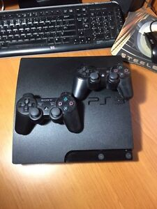 PS3 with 2 controllers and free games West Island Greater Montréal image 2
