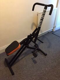 Exercise machine total crunch