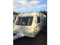 Twin axle caravan/ fixed bed