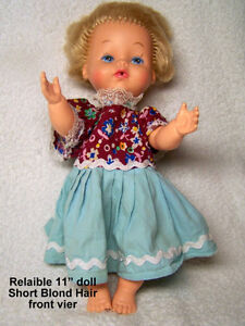Vintage Reliable doll, short blond hair, blue eyes, pink skin