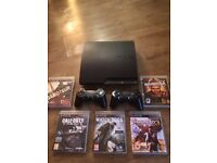PS3 PlayStation 3 slim with pads and games