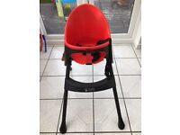 Red and black highchair