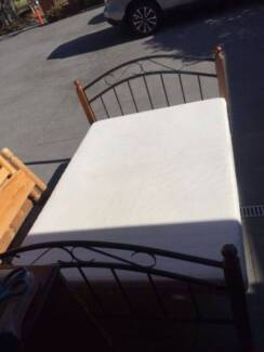nice wooden / metal double size bed frame + mattress , can delive