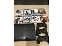 PS3 + 8 games + 3 wireless controllers