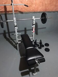 Weight bench and weights London Ontario image 1