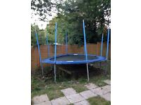 A 14ft blue trampoline enclosure (net) not included