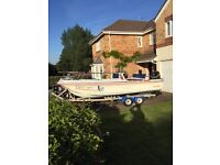Dory 17 feet 115hp Suzuki Fourstroke and roller trailer