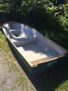 12' fibreglass boat and 6hp Johnson outboard motor