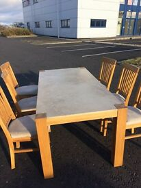 Oak & travertine dining table with 6 oak and fabric chairs