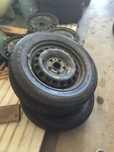 195/65/15 x 2 all seasons tires mounted on VW rims