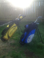Two sets of junior golf clubs