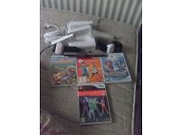 nintendo wii plus 4 games and 4 controllers