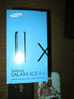 Samsung Galaxy ii x cell phone, cases, headset, charger, guide