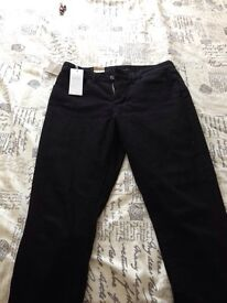 Women's black Levi's jeans