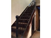 Wrought iron staircase and landing balustrade. £200